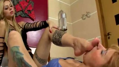 Horny tattooed domina gets her sexy feet licked out by her female foot slave