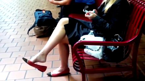 Great looking blonde in sexy skirt gets on voyeur camera thanks to her lovely feet