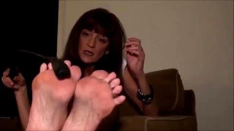 Older brunette uses BDSM whip on feet