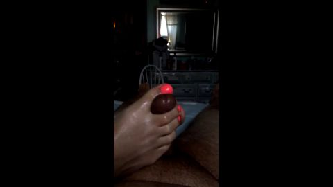 Babe jerking a fat dick with black amateur feet until it explodes
