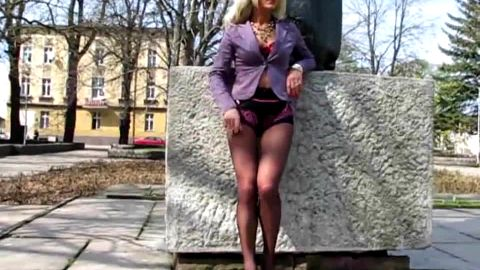Kinky whore wearing sexy underwear and nylon stockings on her long legs and feet outdoors