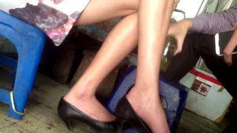 Vietnamese woman in black kitten heels