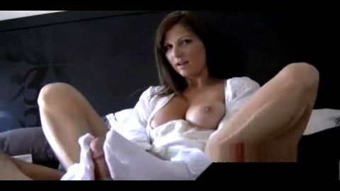 Slutty MILF wearing sexy socks and giving a naughty footjob in bed