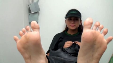 Cute Subway worker takes off sneakers and shows dirty, sweaty feet