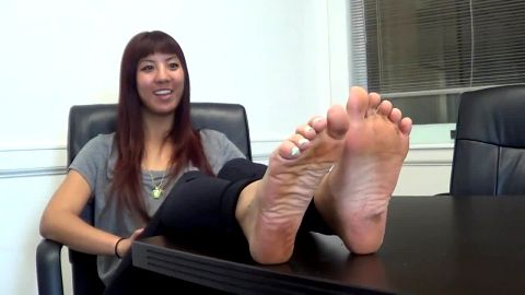 Hot business woman is at the office resting her amazing dirty feet