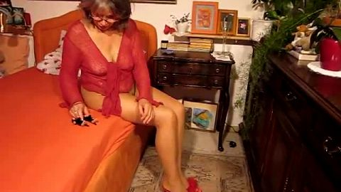 Lovely granny in nylon stockings crushing some toys with her gorgeous feet