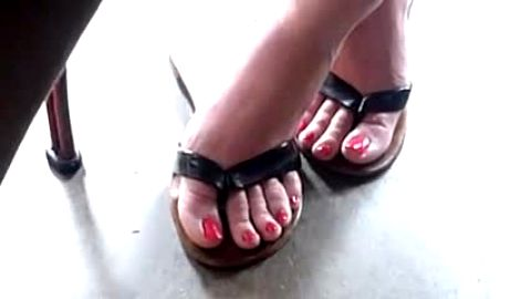 Naughty voyeur camera catches gorgeous feet in sexy flip flops
