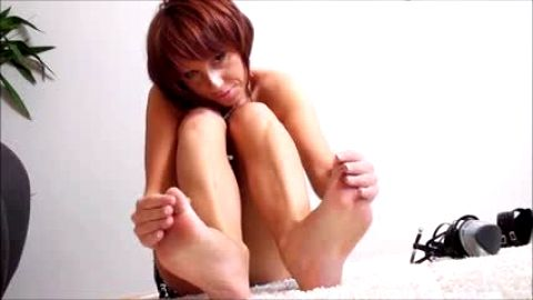 Woman with a delicious pussy licking and worshipping her amazing feet on the floor
