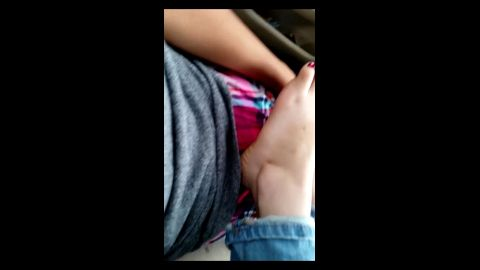 Sexy babe in jeans giving her man a fantastic footjob with her amateur feet in the car