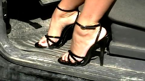 Pumping gas pedal in sexy black strappy sandals