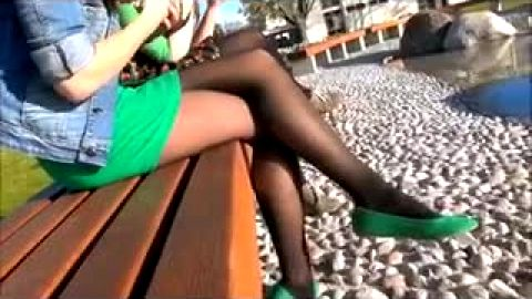 Horny voyeur enjoys seeing sexy girl with hot legs and feet wearing provocative stockings outdoors