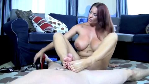 Footjob from busty, stripping beauty