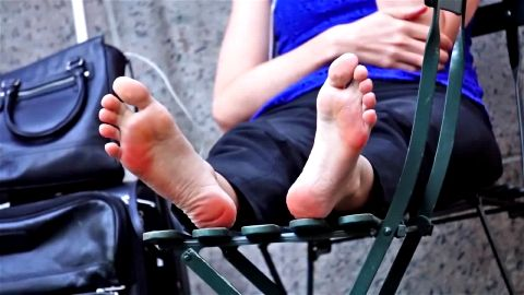 Sophisticated dark haired girl exposes her hot naked feet to horny voyeurs