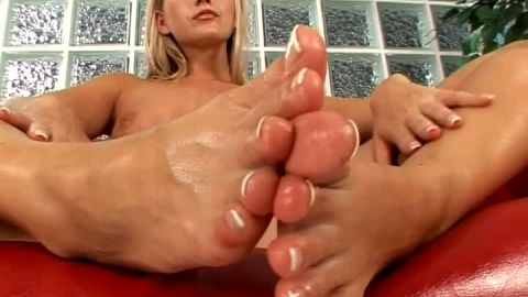 Joana Redgrave oils up her perfectly manicured toes