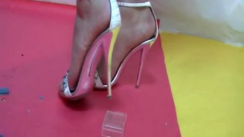 Very high metal heels crushing hard plastic
