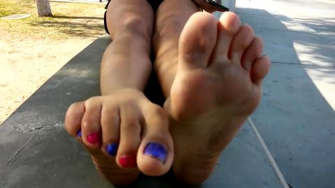 Hottie worshipping her amazing naked feet with nail polish in public