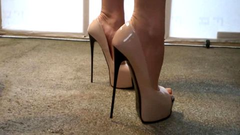 Delicious girl looks super sexy wearing hot shoes with high heels