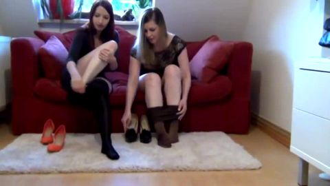 Two kinky German girls trying on their sexy feet some provocative nylon stockings