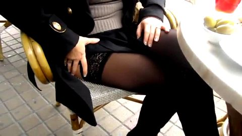Sophisticated girl in black nylon stockings and sexy boots chilling outdoors