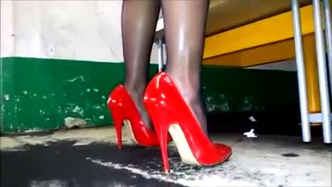Sophisticated mature lady wearing sexy red shoes in an amazing fetish video
