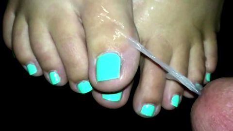 Wife's neon toenails getting my cum