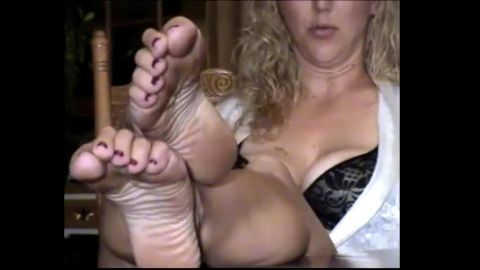 Great looking lady enjoys showing her hot boobs and mature feet while being on the camera