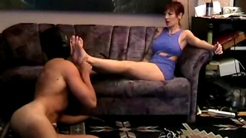 Slutty MILF gets her feet worshipped and licked by a big dick male foot slave