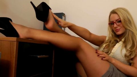 Naughty secretary in nylon stockings takes her shoes off and plays with her feet