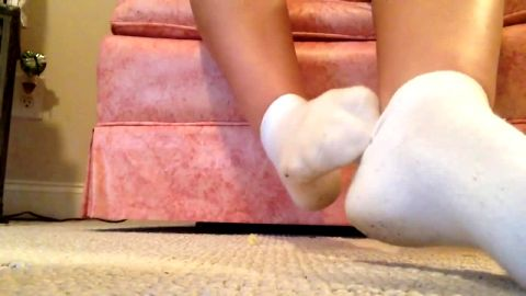 Gorgeous teen slowly takes off her socks and plays with her attractive feet