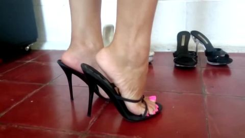 Changing in and out of and dangling sexy sandals