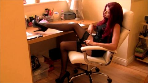 Perfect MILF redhead enjoys wearing sexy black nylon stockings on over her feet
