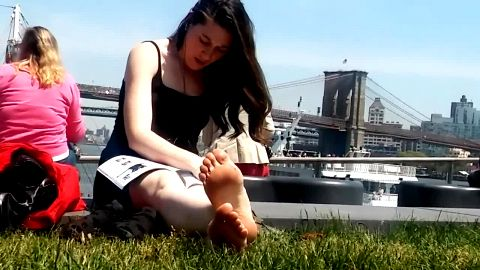 Sweet girls sitting outdoors and showing their amazing voyeur feet