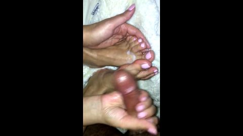 Fantastic handjob leads to cum on bare feet