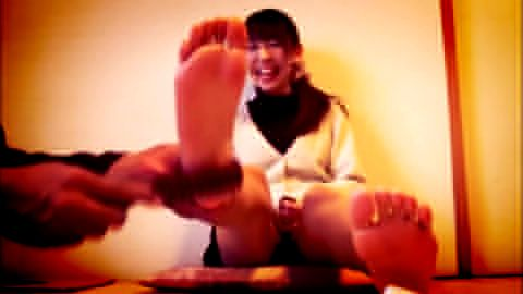 Asian girl tickled in black pantyhose and schoolgirl skirt