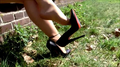 Naughty girl wearing sexy black high heel shoes in hot shoe dangling video