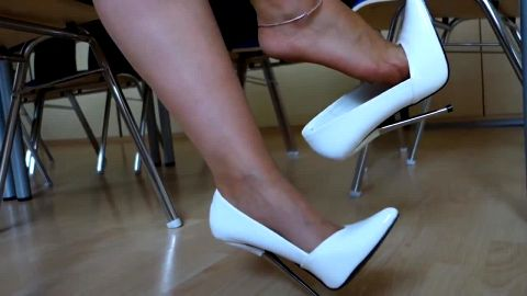 Sexy white shoes with metal high heels in breath taking shoe dangling video