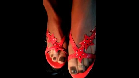 Open-toe strappy sandals with red stars