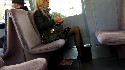 Gorgeous mature woman wearing stockings and sexy shoes over her lovely feet