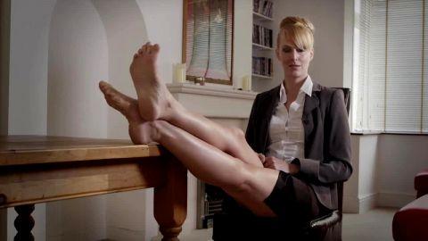 Smoking hot MILF in sexy uniform and nylon stockings loving her amazing feet