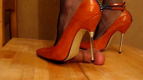 Orange metal heels giving painful cock crushing