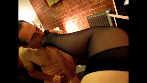 Nasty dude jerking his cock while licking a hot woman's feet in bed