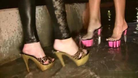 Two smoking hot girls in sexy outfits exploring their foot fetishes in public