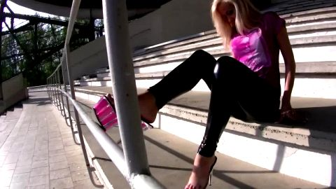 Slipping into magenta see through platforms and climbing stairs