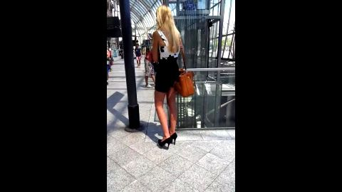 Attractive teen in high heels showing her sexy voyeur feet in public