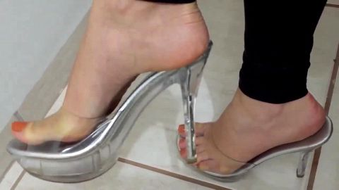 Horny girl with a shoe fetish exposes her amazing feet with orange nail polish