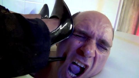 Bald male foot slave gets tortured and punished by his black mistress