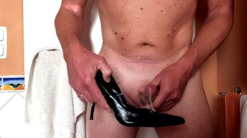 Horny naked guy jerking off and cumming on sexy black shoes