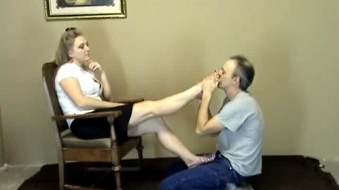 Naughty blonde loves playing games with her male foot slave