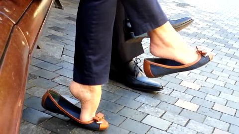 Sophisticated girl enjoys playing with her shoes and voyeur feet in public
