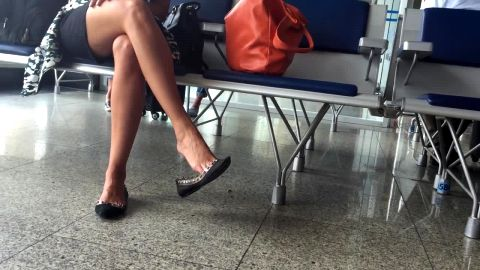 Attractive Brazilian girl loves playing with her shoe and dangling in public